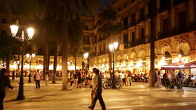 Night view of Placa Reial with restaurants stock video footage
