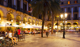 Night view of Placa Reial with restaurants Stock Images