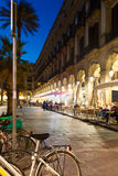Night view of Placa Reial with restaurants Royalty Free Stock Images