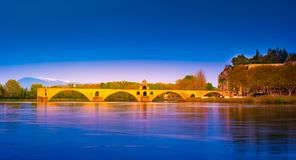Night view of Pont d`Avignon over river Rhone, France stock photography