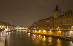 A night view from Pont Saint-Michel. On the Sena river in Paris Royalty Free Stock Images