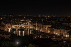 Night view of Ponte Vecchio on the Arno river royalty free stock image