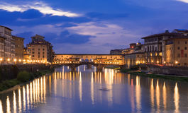 Night view of Ponte Vecchio over Arno River in Florence Stock Photos