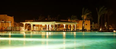 Night view of the pool and bar. Travel and rest Stock Photography