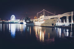 Night view of the port of Malaga. Big cruises ships and ferris w Stock Photography
