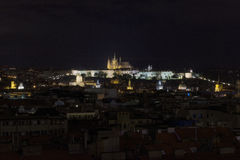 Night view of Prague castle. Panorama of Prague castle, St. Vitus Cathedral, St. Nicholas church, the Lesser Town and other Prague churches Stock Images
