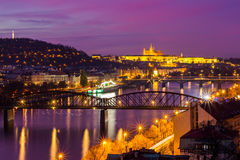 Night view of the prague castle and railway bridge over vltava/moldau river in prague taken from the top of vysehrad castle Stock Photography