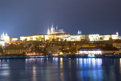 Night view of Prague, Czech Republic: river Vltava, Hradcany, castle and St. Vitus Cathedral Royalty Free Stock Images