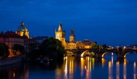 Night view of Prague Powder Tower and Charles bridge Stock Images