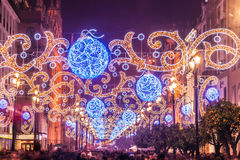 Christmas lights in the avenue of Seville. Night view of the principal avenue of Seville illuminated with lights for Christmas Royalty Free Stock Photo