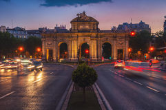 Night view of The Puerta de Alcala in Madrid. Night view of The Puerta de Alcala at sunset - a monument in the Independence Square in Madrid, Spain. Motion Royalty Free Stock Image