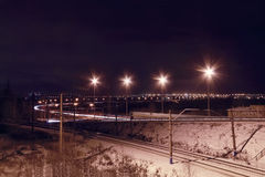 Night view of railroad with lanterns and lights of city Royalty Free Stock Photo