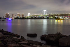 Night view of Rainbow Bridge and the surrounding Tokyo Bay area as seen from Odaiba,Minato, Tokyo, Japan. Royalty Free Stock Images