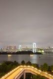 Night view of Rainbow Bridge and the surrounding Tokyo Bay area as seen from Odaiba,Minato, Tokyo, Japan. Royalty Free Stock Photo