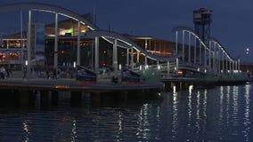Night view of Rambla de Mar, footbridge modern design in the port of Barcelona. stock video footage