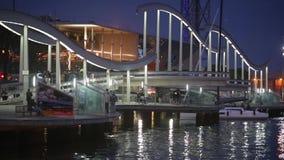 Night view of Rambla de Mar footbridge modern design in the port of Barcelona. stock video