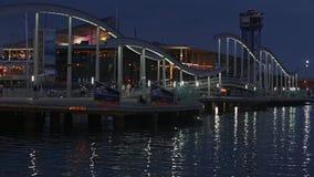 Night view of Rambla de Mar, footbridge modern design in the port of Barcelona.Time Lapse stock video footage