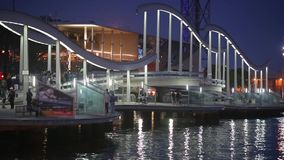 Night view of Rambla de Mar, footbridge modern design in the port of Barcelona.Time Lapse stock footage