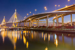 Night view reflection of Suspension bridge with highway intersection Stock Photos