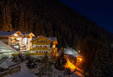 Night view at the resort at the mountain slopes. (Dolomites, Italy Royalty Free Stock Photo