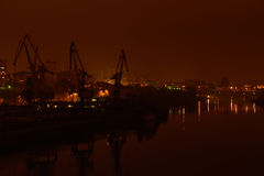 Night view of river port. Bridge and buildings Royalty Free Stock Image