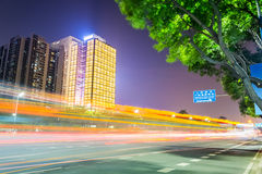 Night view of road with modern building Stock Image