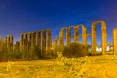 Night view of  roman aqueduct. At Merida. Extremadura, Spain Royalty Free Stock Photos