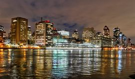 Night View from Roosevelt Island  of midtown NewYork. Night View from Roosevelt Island  of midtown high rises New York. Evening light. Reflections from the East Royalty Free Stock Images