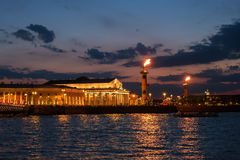 Night view of the rostral columns, Exchange Building, Neva from the Palace Embankment. St. Petersburg, Russia Stock Image