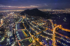 Night view of Santiago de Chile toward the east part of the city, showing the Mapocho river and Providencia and Las Condes distric. Ts Royalty Free Stock Image