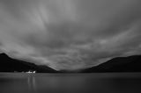 Night view on scottish lake Earn. Night view on Loch Earn in Scotland with silhouettes of mountains and dynamic clouds, Loch Lomond and Trossachs National Park Royalty Free Stock Images