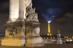 Night view of sculpture. On Pont Alexandre III bridge. Eiffel tower is in background in Paris Royalty Free Stock Photography
