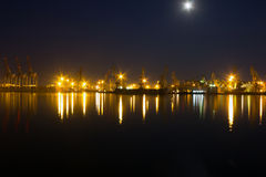 Night view on sea port Stock Photos