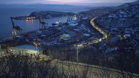 Night view of seaport, city street road with moving cars on shore of Pacific Ocean. KAMCHATKA PENINSULA, RUSSIAN FAR EAST - 26 APRIL, 2018: Scenery night view of stock video