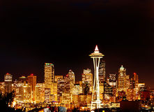 Night View on Seattle Skyline with Space Needle. Night View on golden Seattle Skyline - Lighted Office Buildings with Space Needle Tower Royalty Free Stock Images