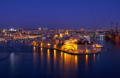 The night view of Senglea peninsula from Valletta, Malta Stock Photo