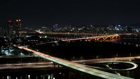 The night view of Seoul. Time lapse expressway top view.