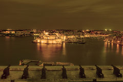 Night view sepia tinted on Valletta Grand harbor from the historic Upper Barraka garden Stock Photography