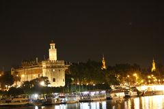 Night view of Seville with its river Guadalquivir and the Torre del Oro. (Spain stock images