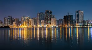 Night view of Sharjah UAE. SHARJAH, UAE - OCTOBER 29: Night view of Sharjah, on October 29, 2013. Sharjah is located along northern coast of Persian Gulf on royalty free stock photography