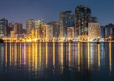 Night view of Sharjah UAE. SHARJAH, UAE - OCTOBER 29: Night view of Sharjah, on October 29, 2013. Sharjah is located along northern coast of Persian Gulf on stock photos