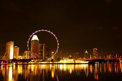 Singapore flyer skyline at night. Singapore flyer in the night, lights on, so beautiful Stock Photo