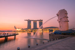 Night view of Singapore Merlion. At Marina Bay against Singapore skyline. Merlion is a well-known tourist icon, mascot and national personification of Singapore Stock Photos