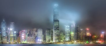 Skyline of Hong Kong in mist from Kowloon, China. Night view and skyline of Hong Kong in mist from Kowloon, China Royalty Free Stock Image
