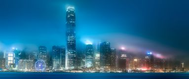 Skyline of Hong Kong in mist from Kowloon, China. Night view and skyline of Hong Kong in mist from Kowloon, China royalty free stock images