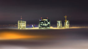 Night view at skyscrapers with foggy waves, Prague, Czech republic Royalty Free Stock Photos