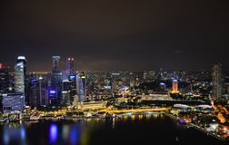 The night sky of Singapore. Reflections and glare on the water. City view royalty free stock photo