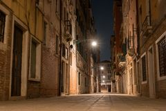 Night view of a small street in Venice, Italy. Architecture and sights of Venice. Nightlife in Venice. Venetian postcard Stock Photo