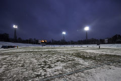 Night view of the snow-covered stadium Stock Images