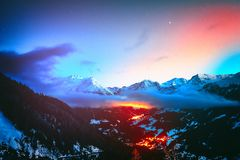 Night view on snowy peaks of Saint-Luc mountains, Alps Switzerla royalty free stock photography